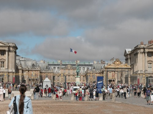 Outside Versailles with a crowd of people